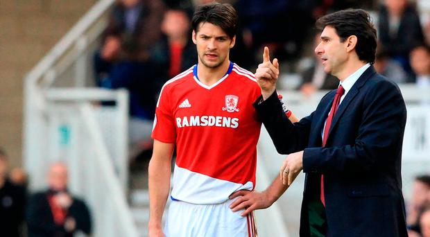 Middlesbrough's Spanish manager Aitor Karanka speaks with his captain, Middlesbrough's English defender George Friend. Photo: Lindsey Parnaby/Getty Images