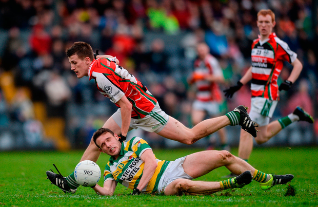 John O'Rourke of Carbery Rangers in action against Shane Murphy of Ballincollig. Photo: Sportsfile