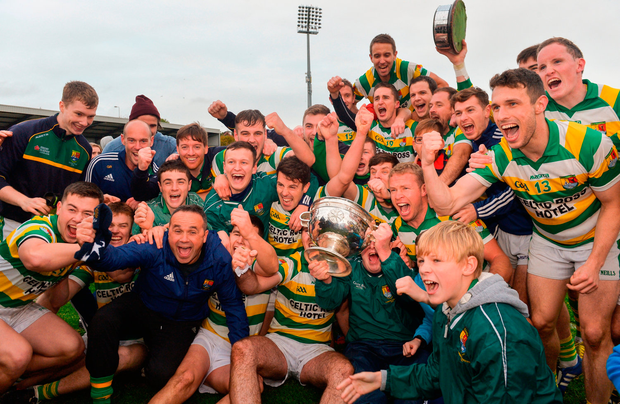 Carbery Rangers players and supporters celebrate with the Andy Scannell cup. Photo: Sportsfile