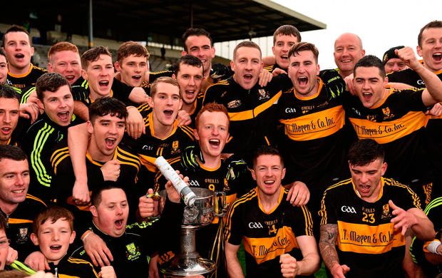 Dr. Crokes captain Johnny Buckley, centre, and his team-mates celebrate with the Bishop Moynihan Cup. Photo: Sportsfile