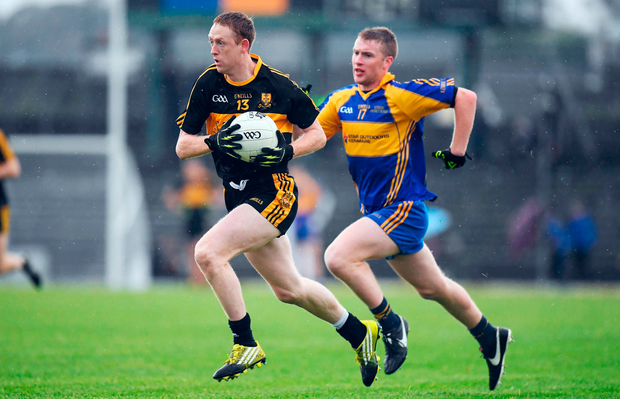 Colm Cooper of Dr. Crokes paces past Kevin O'Sullivan. Photo: Sportsfile