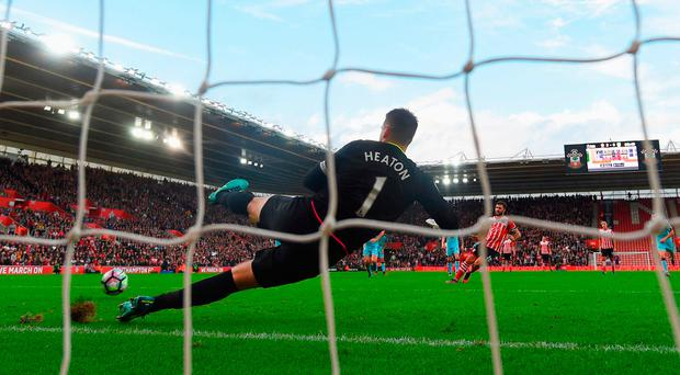 Charlie Austin of Southampton scores their third goal from the penalty spot past goalkeeper Tom Heaton of Burnley. Photo by Mike Hewitt/Getty Images