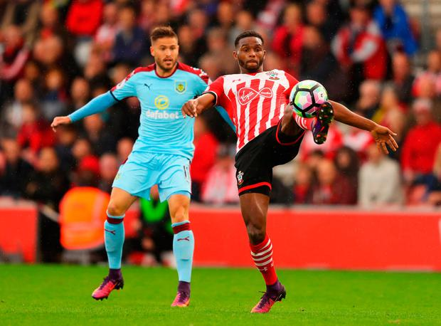 Cuco Martina of Southampton holds off Michael Kightly of Burnley. Photo by Richard Heathcote/Getty Images