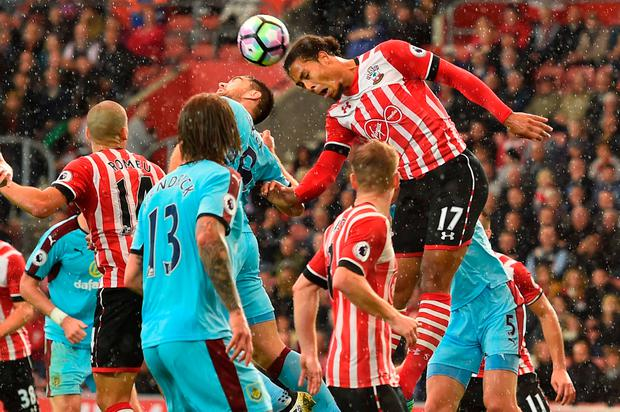 Southampton's Dutch defender Virgil van Dijk heads the ball. Photo: Glyn Kirk/Getty Images