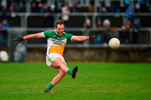 Michael Murphy of Glenswilly powers a shot at goal. Photo: Sportsfile