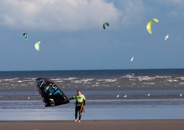 A man emerges from the sea after kitesurfing in Bull Island. Picture by Fergal Phillips