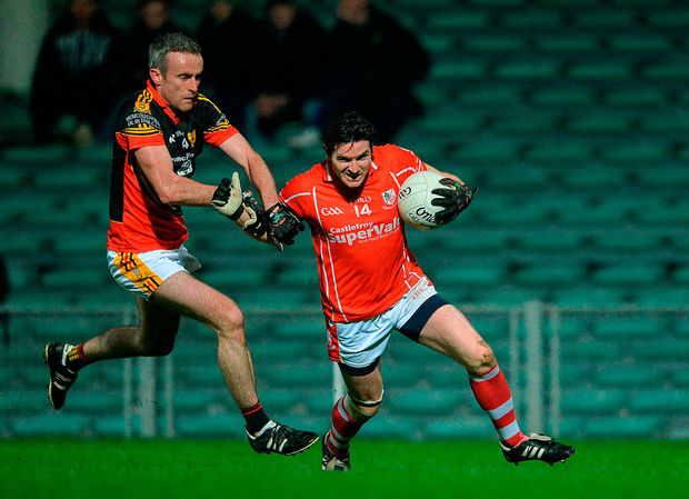 Ger Collins of Monaleen in action against Gary Egan of Dromcollogher-Broadford. Photo: Sportsfile