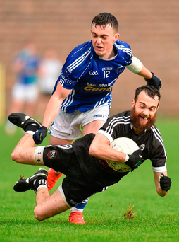 Conor Laverty of Kilcoo tries to get away from Scotstown's Sean Mohan during yesterday's Ulster Club SFC first round clash at Clones. Photo: Sportsfile