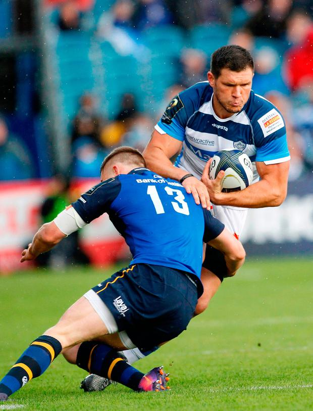 Castres wing Remy Grosso is tackled by Leinster's centre Garry Ringrose. Photo: Getty Images