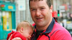 Anthony Foley holds his then five-week-old son Tony at the launch of the new Munster Rugby jersey in 2005. Photo: Kieran Clancy