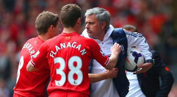 Jose Mourinho shields the ball during Chelsea's win at Anfield in 2014 (Getty)