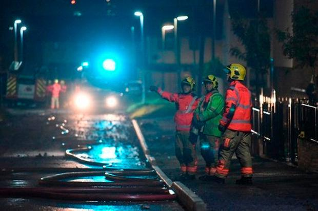Handout photo issued by Greater Manchester Fire and Rescue Service of a fire which has torn through what appears to be a block of partially built flats in Gorton, Manchester Credit: GMFRS/PA Wire