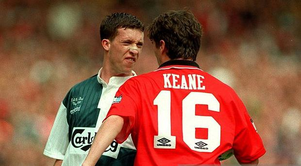 Roy Keane tangles with Robbie Fowler