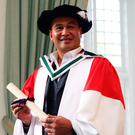 Pat Lam with the honorary degree he received from NUI Galway yesterday for his achievements as head coach of Connacht Photo: Andrew Downes