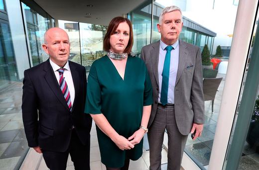 AGSI President Antoinette Cunningham pictured alongside Solicitor Michael Hegarty (Smyth, O'Brien, Hegarty Solicitors) and John Jacob General Secretary following the AGSI vote at the Special Delegate Conference for a withdrawl of labour at the Sheraton Athlone. Pic Steve Humphreys