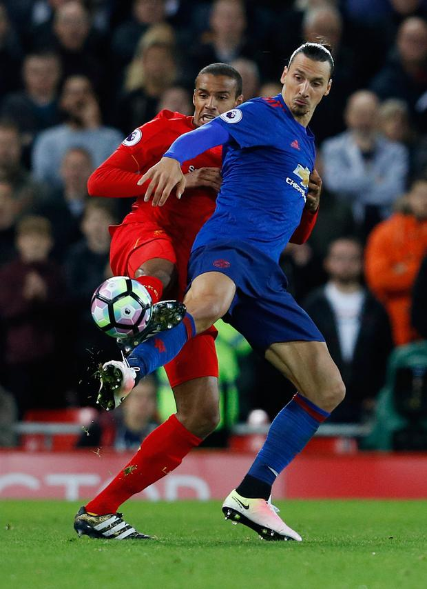 (L-R) Liverpool's Joel Matip shackles United's Zlatan Ibrahimovic at Anfield last night Photo: Reuters / Phil Noble