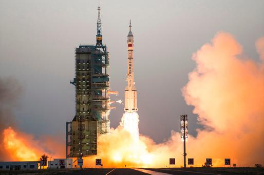 China's Shenzhou 11 spaceship onboard a Long March-2F carrier rocket takes off from the Jiuquan Satellite Launch Center in northwest China's Gansu province. Photo: AP