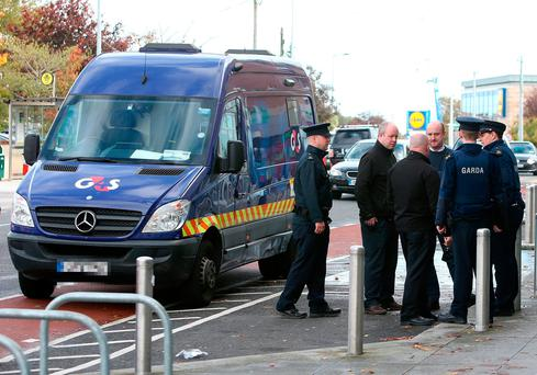 Gardaí outside the bank in Tallaght where a cash van was robbed. Photo: Damien Eagers