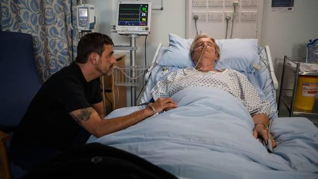 Peter Barlow, played by Chris Gascoyne, at the bedside of his father Ken, played by William Roache (Mark Bruce/ITV/PA Wire)