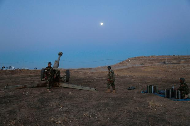 Kurdish security forces take up a position as they fight overlooking the Islamic State-controlled in villages surrounding Mosul, in Khazer (AP Photo)