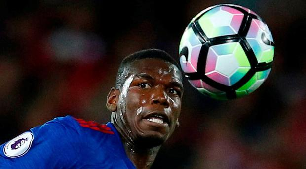 Manchester United's Paul Pogba in action with Liverpool's Jordan Henderson Reuters / Phil Noble