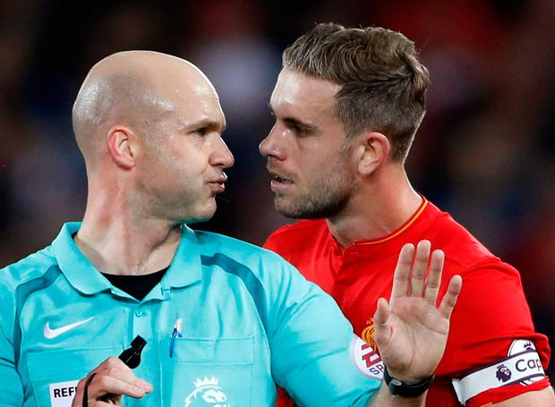 Britain Football Soccer - Liverpool v Manchester United - Premier League - Anfield - 17/10/16 Liverpool's Jordan Henderson talks to referee Anthony Taylor Action Images via Reuters / Carl Recine Livepic EDITORIAL USE ONLY. No use with unauthorized audio, video, data, fixture lists, club/league logos or