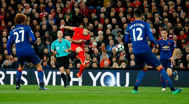 Liverpool's Adam Lallana shoots against Manchester United last October