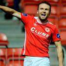 Conan Byrne celebrates after scoring his side's third goal but very few people were there to see it