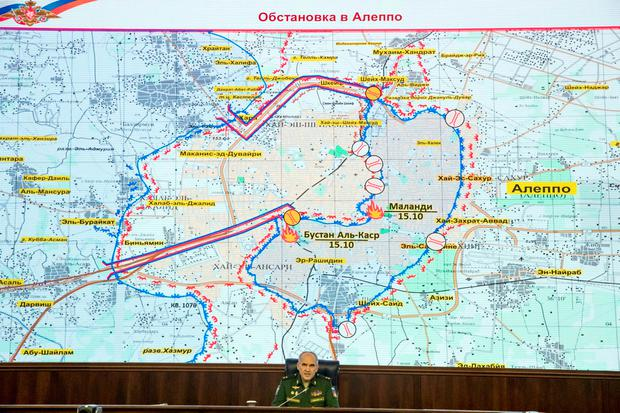 Lt. Gen. Sergei Rudskoi of the Russian military's General Staff speaks to the media, with a map of the area around Aleppo seen in the background, at the Russian Defense Ministry's headquarters in Moscow, Russia (AP Photo/Pavel Golovkin)