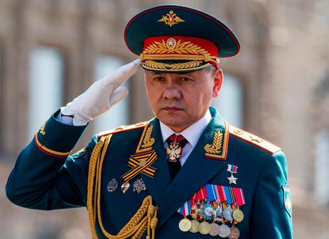 Russian Defense Minister Sergei Shoigu salutes to his soldiers as he is driven along Red Square during a rehearsal for the Victory Day military parade which will take place at Moscow's Red Square on May 9 to celebrate 71 years after the victory in WWII in Moscow, Russia (AP Photo/Alexander Zemlianichenko, file)