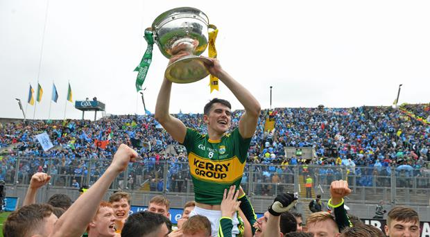 Kerry's Mark O'Connor celebrates with the cup after winning last year's All-Ireland minor title