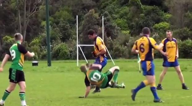 Rory O'Carroll sends an opponent crashing to the floor