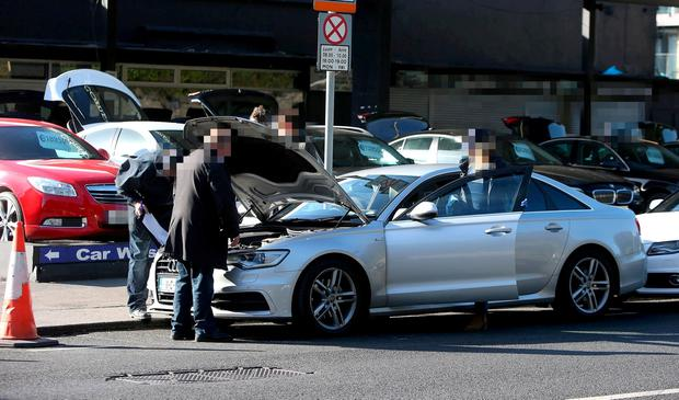 Members of CAB and Gardai check vehicles from a motor company in Dublin. Picture: Damien Eagers