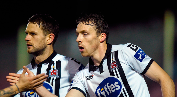 David McMillan, right, of Dundalk celebrates after scoring his side's second goal with teammate Dane Massey against Longford