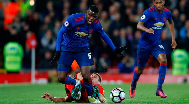 Manchester United's Paul Pogba in action Liverpool's James Milner