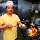 Chef Thang prepares a meal at the Ly Garden Chinese takeaway in Tallaght. Photo: Arthur Carron
