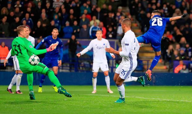 Leicester City's Riyad Mahrez (right) scores his side opening goal