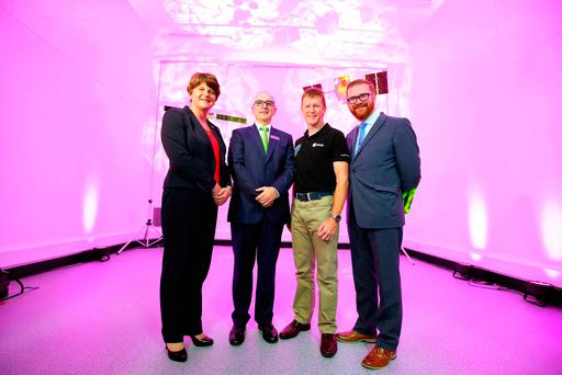 Northern Ireland's First Minister Arlene Foster, Philip McBride of Thales Belfast, astronaut Tim Peake and Economy Minister Simon Hamilton at the new space industry facility in Belfast. Photo: Kelvin Boyes/Press Eye /PA Wire