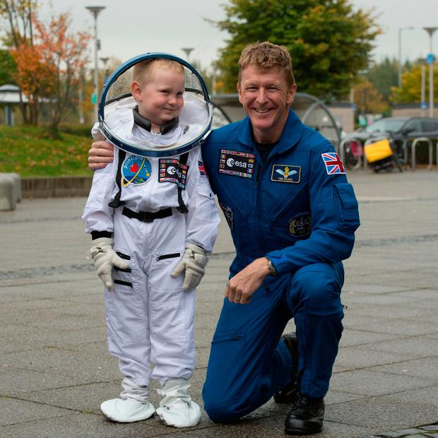 Tim Peake with Callum Milligan (5) during a visit to the Glasgow Science Centre on Sunday. Photo: John Linton/PA Wire