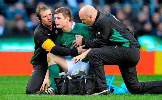 Rugby star Brian O'Driscoll is held by team medics after falling to the ground twice with suspected concussion during a Six Nations game in 2010. Photo: Sportsfile