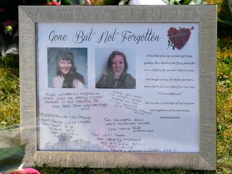 Tributes left outside a house in Spalding, Lincolnshire, where the bodies of 49-year-old Elizabeth Edwards and 13-year-old Katie were found. Photo: PA