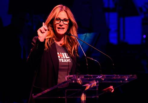 Julia Roberts speaks during the The Hillary Victory Fund Stronger Together Concert at the St. James Theatre in New York. Photo: AFP/Getty Images