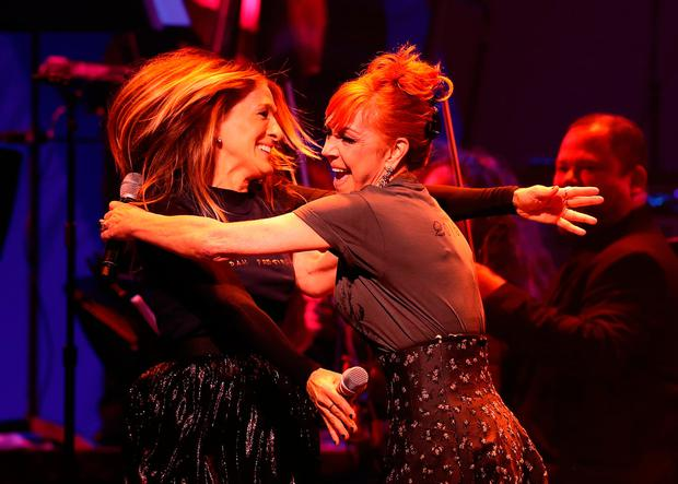 Sarah Jessica Parker and Andrea McArdle perform during the Hillary Victory Fund - Stronger Together concert at St. James Theatre in New York. Photo by Justin Sullivan/Getty Images