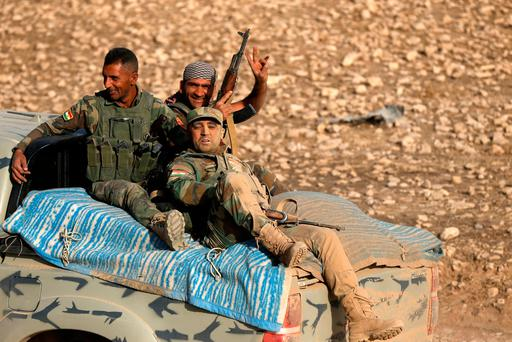 Peshmerga forces sit in the back of a vehicle in the east of Mosul during an operation to attack Islamic State militants in the city. Photo: Reuters
