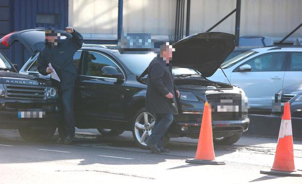 Members of CAB and Gardai check vehicles at a Motor Company in Dublin. Picture: Damien Eagers