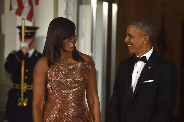US President Barack Obama and First Lady Michelle Obama wait for the arrival of Italian Prime Minister Matteo Renzi and his wife Agnese Landini on the North Portico of the White House before a state dinner in Washington, DC on October 18, 2016. / AFP / Nicholas Kamm (Photo credit: NICHOLAS KAMM/AFP/Getty Images)