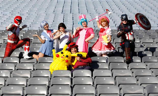 Pictured in Dublin's Croke Park Stadium are Andrew Mahon as Marvel's Captain America, Juli Neeson (pink hat) as Sakura from Cardcaptors, Julia Vasiljeva (black hair) as Studio Ghibli's Princess Mononoke, Rachel Ralph (light blue hair) Kirenshi Cosplay as Hatsune Miku, Saturn(purple hair)13 Cosplay as Rei Ayanami from Evangelion, Stephen Lynch as Red Power Ranger, Michael Abrahamson-Mr Balloonatic with a balloon Pokemon. Photo: Sasko Lazarov/Photocall Ireland