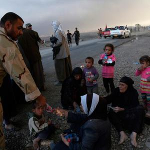 People rest as they flee their homes during clashes between Iraqi security forces and members of the Islamic State group fleeing Mosul, Iraq, Tuesday, Oct. 18, 2016. (AP Photo)