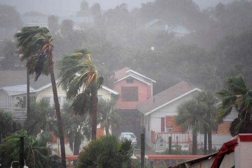 Rain batters homes as the eye of Hurricane Matthew passes Daytona Beach, Florida. The event also caused movement in stock prices of property funds. Photo: Reuters
