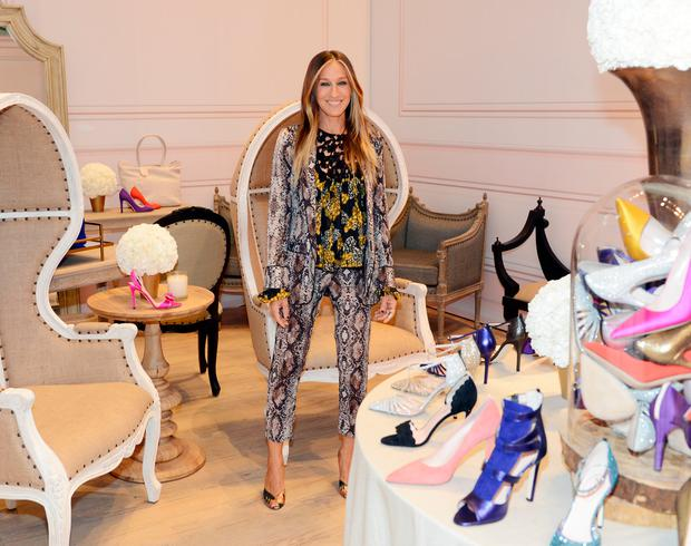 Best foot forward: Sarah Jessica with some of her shoe range, SJP